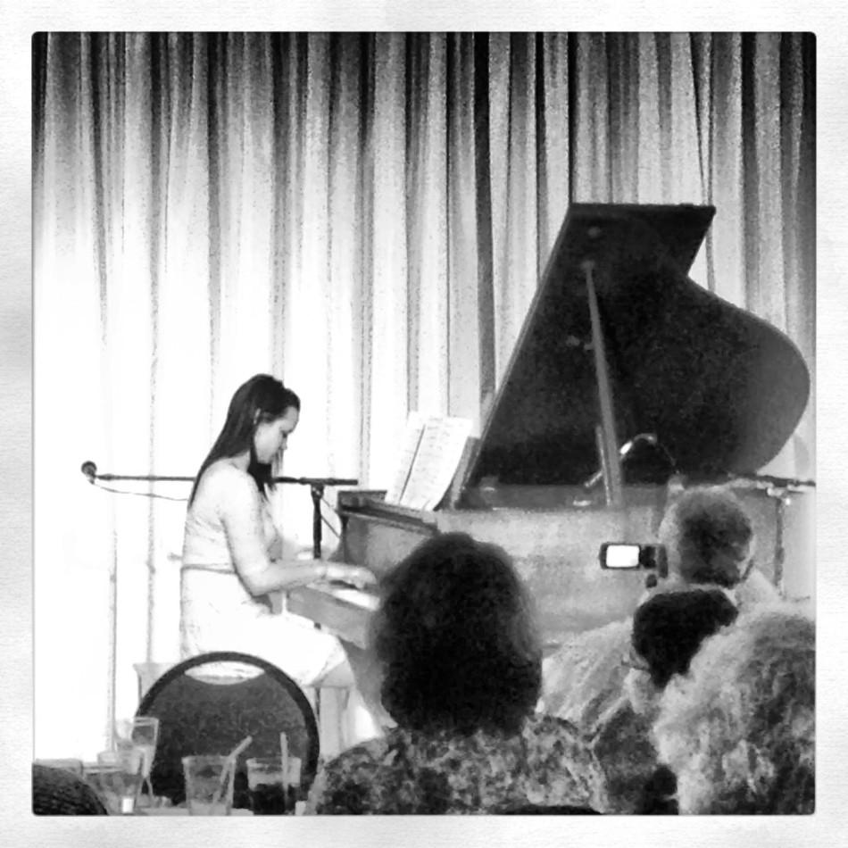 Elena Elliot playing the piano at her first big recital.