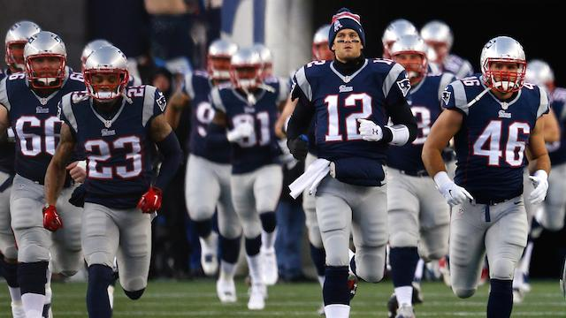 FOXBORO%2C+MA+-+JANUARY+10%3A++Tom+Brady+%2312+of+the+New+England+Patriots+runs+onto+the+field+with+teammates+before+the+2015+AFC+Divisional+Playoffs+game+against+the+Baltimore+Ravens+at+Gillette+Stadium+on+January+10%2C+2015+in+Foxboro%2C+Massachusetts.++%28Photo+by+Jim+Rogash%2FGetty+Images%29