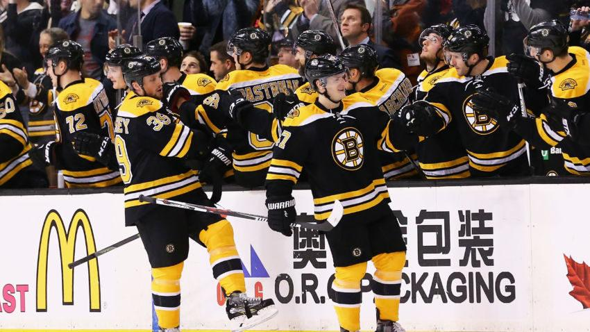 BOSTON, MASSACHUSETTS - APRIL 07:  Torey Krug #47 of the Boston Bruins celebrates with Matt Beleskey #39 and teammates after scoring against the Detroit Red Wings during the second period at TD Garden on April 7, 2016 in Boston, Massachusetts.  (Photo by Maddie Meyer/Getty Images)
