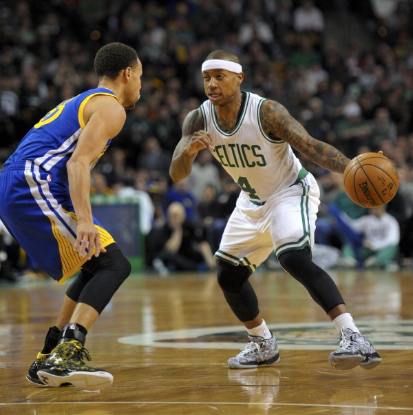 Mar 1, 2015; Boston, MA, USA; Boston Celtics guard Isaiah Thomas (4) controls the ball while being defended by Golden State Warriors guard Stephen Curry (30) during the first half at TD Garden. Mandatory Credit: Bob DeChiara-USA TODAY Sports