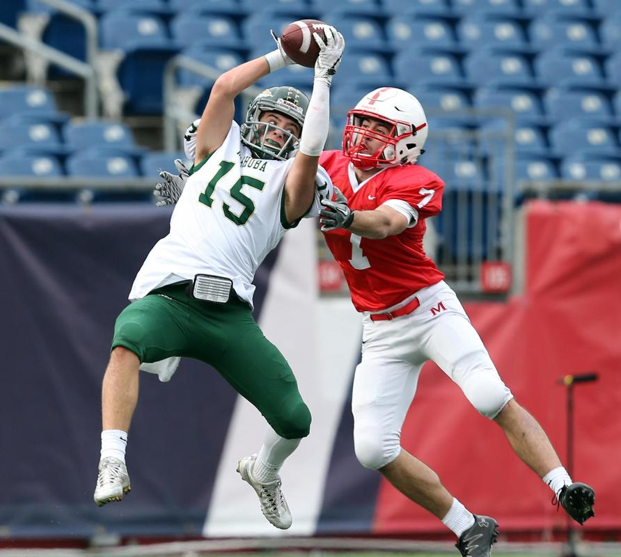 (Foxborough, MA 12/02/17) Nashoba's #15 Breese Hill makes an interception of a pass intended for Melrose's #7 Cameron Rosie in the 2nd quarter of their MIAA Division 4 State Championship game at Gillette Stadium. Saturday, December 2, 2017. Staff photo by John Wilcox.