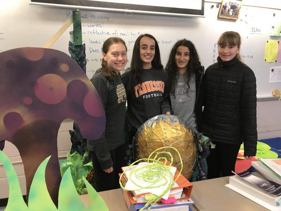 From left to right: Shannon Henderson , Else Snoonian, Charlotte Snoonian, and Colleen Henderson standing in front of their props.