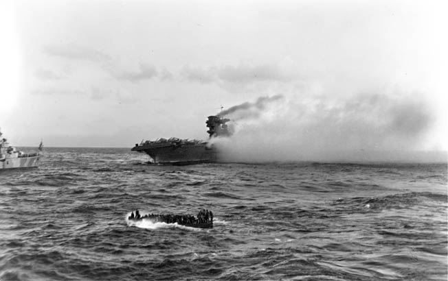 The+USS+Lexington+sinking+after+the+ship+had+been+abandoned.+