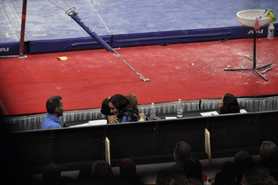 Former Gymnast Jordyn Wieber hugs Margzetta Frazier, gymnast from UCLA.  Wieber is the first female olympic champion to coach a gymnast at the national championships