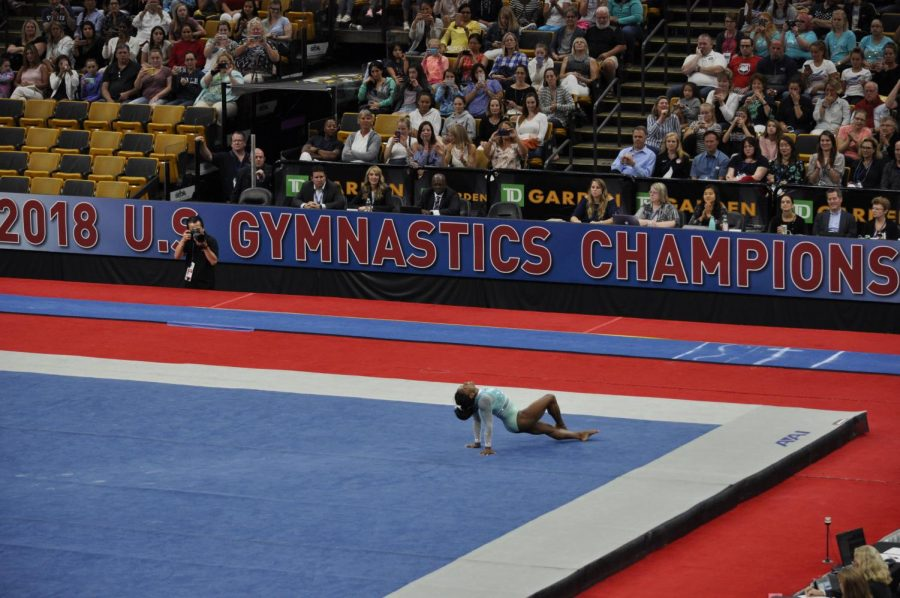 Olympic champion, Simone Biles, completes her floor routine.