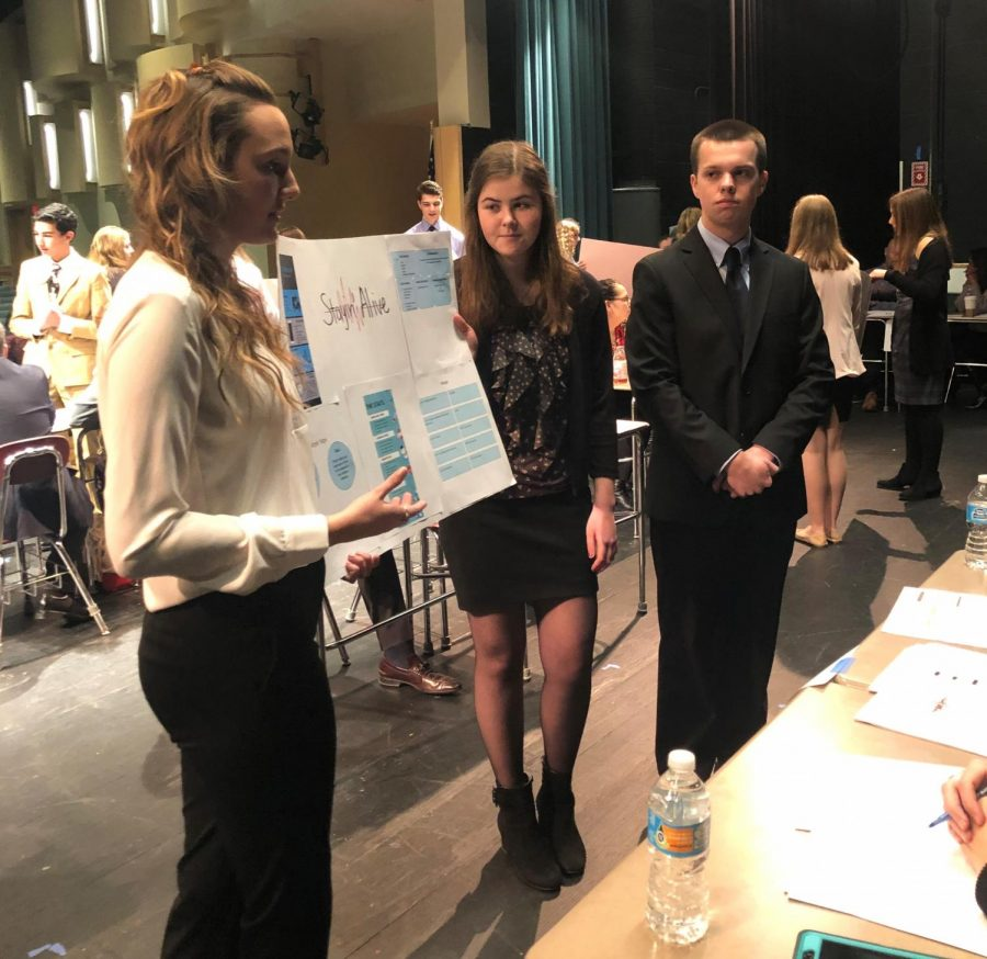 DECA students present to judges