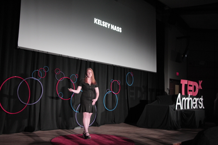 Kelsey Nass giving her TED talk at the TEDxAmherst conference.